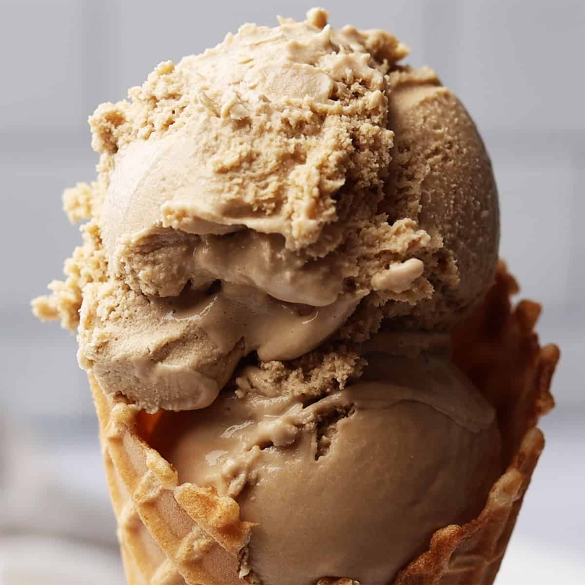 up close photo of two scoops of Coffee Ice Cream in a waffle cone