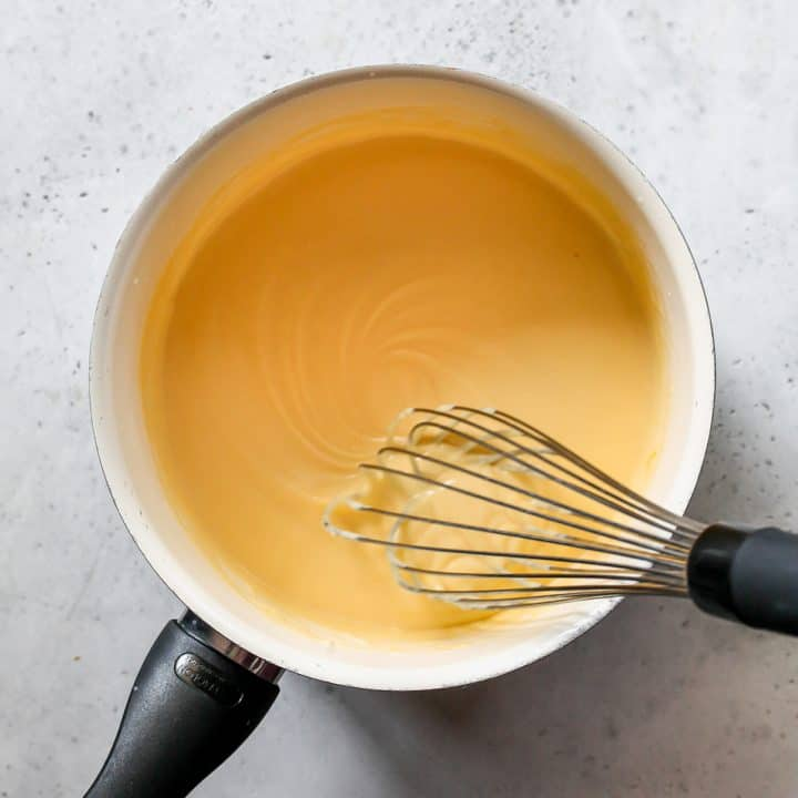photo showing how to make cheese sauce - whisking the smooth sauce