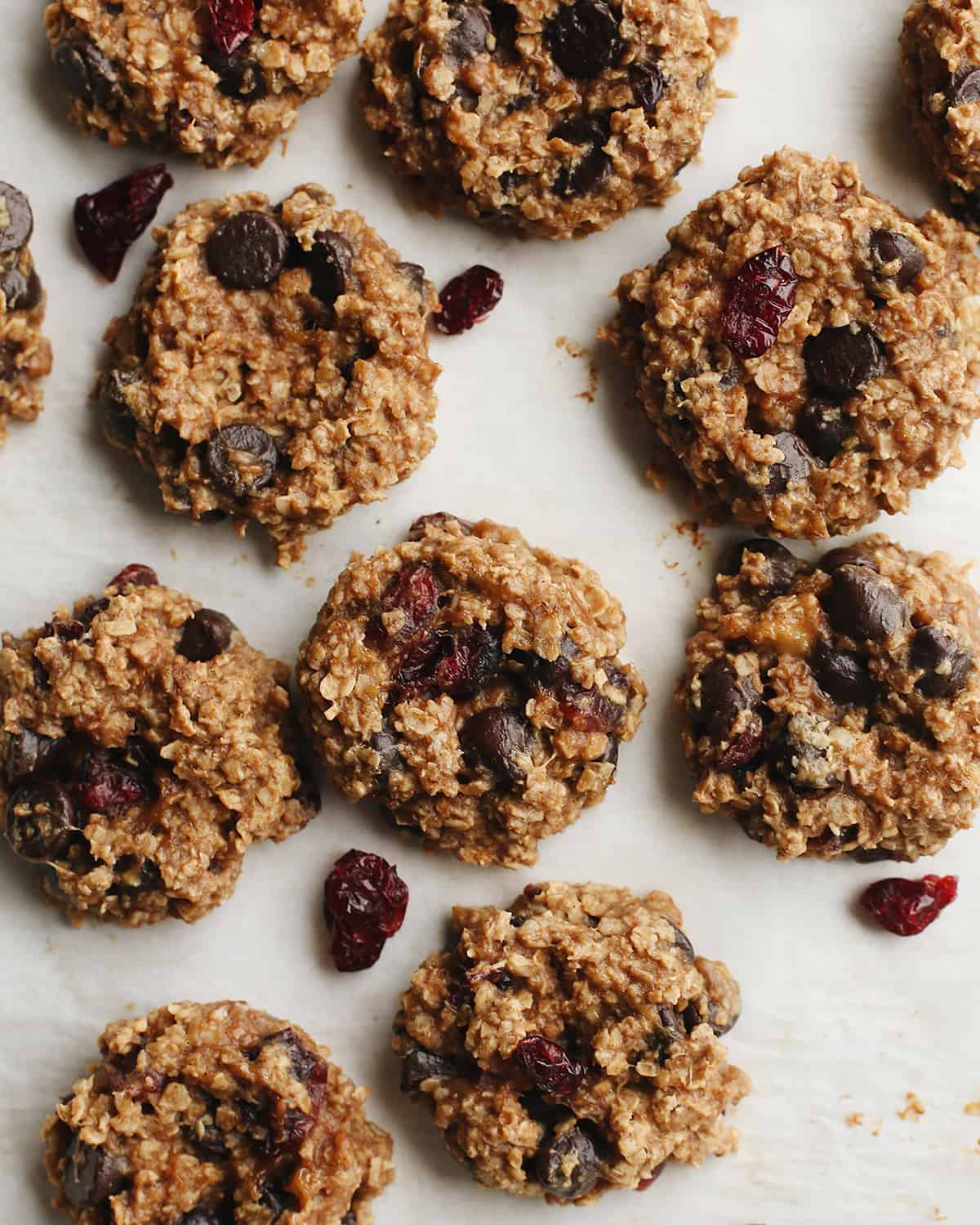 overhead photo of 9 Peanut Butter Banana Cookies with chocolate chips and dried cranberries