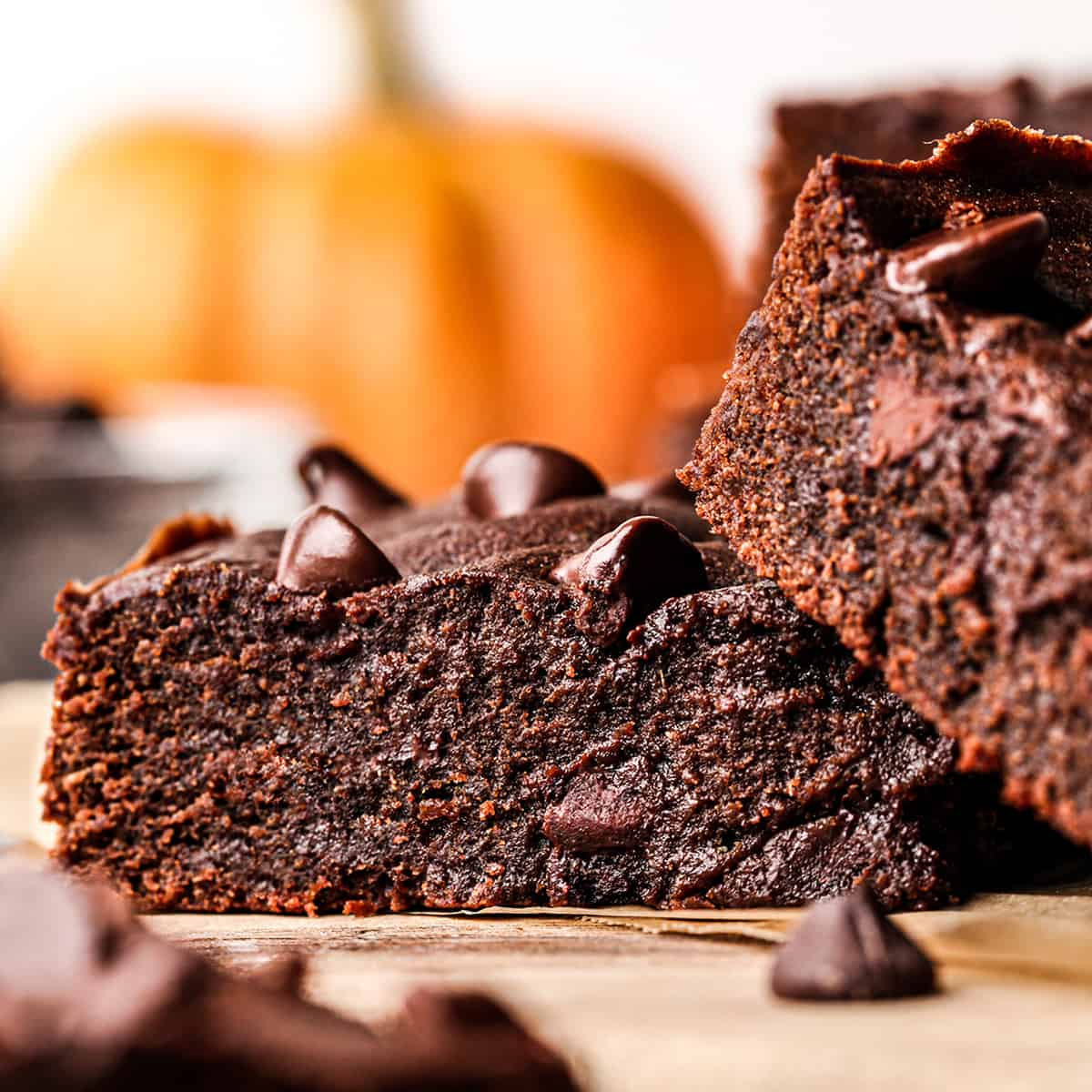 up close front view of two Pumpkin Brownies, one stacked slightly on the other