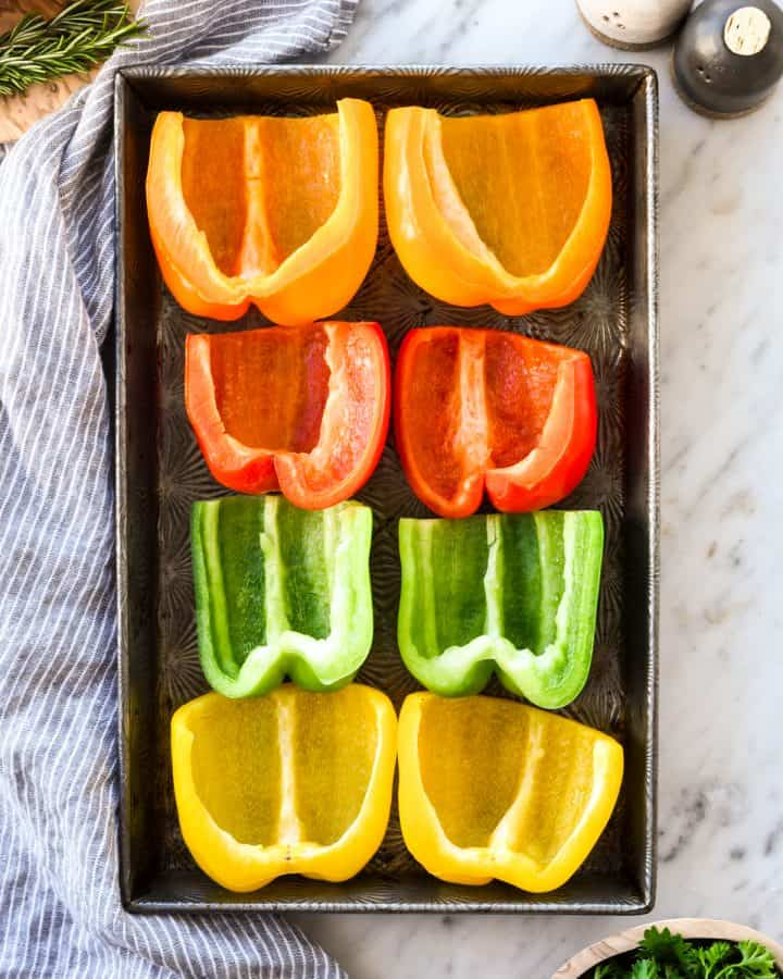 overhead view of peppers being cooked in this Italian Stuffed Peppers recipe
